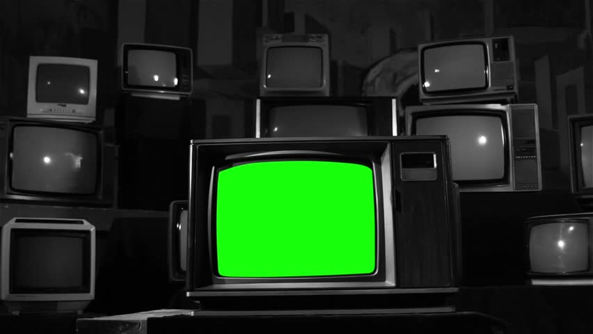 "Retro TV with Green Screen over a Pile of Retro TVs. Dolly In. Black and White Tone. You can Replace Green Screen with the Footage or Picture you Want with ""Keying"" effect in AE (check tutorials).  
