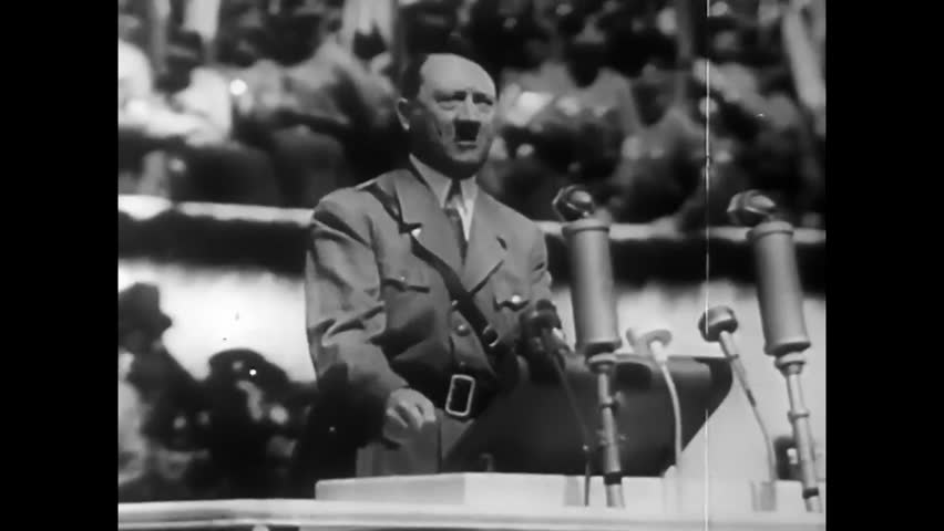 CIRCA 1940s - Adolf Hitler speaks at a Nazi rally and, later, defeated, paintings of him are burned and stomped in 1944.