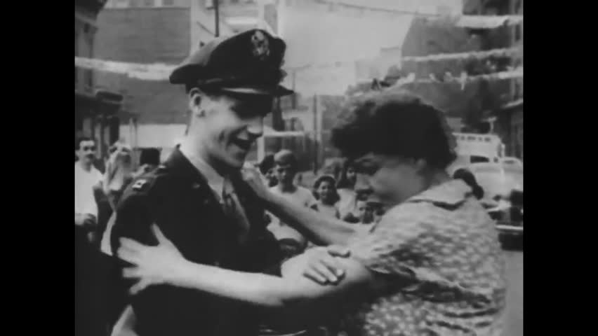 CIRCA 1940s - World War II ends and the world celebrates as soldiers are welcomed home.