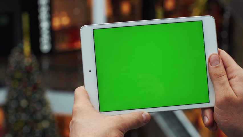 Man using horizontal tablet with green screen. Close-up shot of man's hands with tablet. Chroma key. Close up. Horizontal | Shutterstock HD Video #1006748377