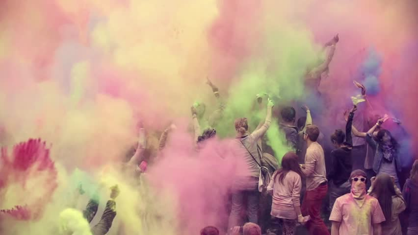 Hamburg - germany, octobers 2016. multi ethnic group of teens celebrating holi festival color, shot in epic slow motion