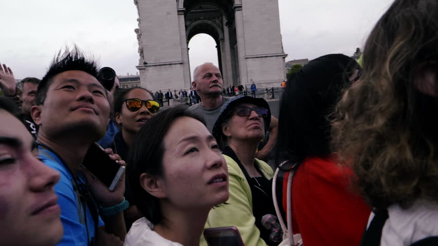 PARIS, FRANCE - JULY 23, 2017:Crowd of people watching, looking up - HDR HLG slowmo. Tourism and covid-19 / corona virus, need for social distancing, quarantine to avoid infection.