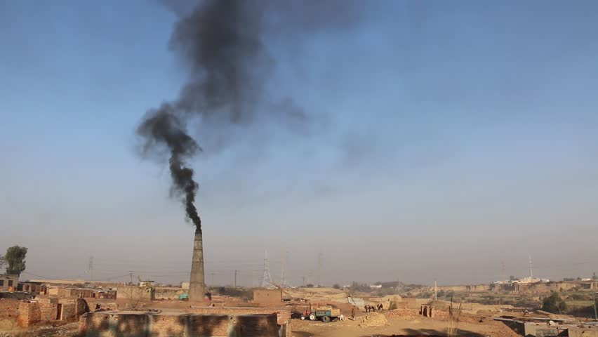 Heavy poisonous smoke coming from a brick factory chimney polluting environment. | Shutterstock HD Video #1006799497