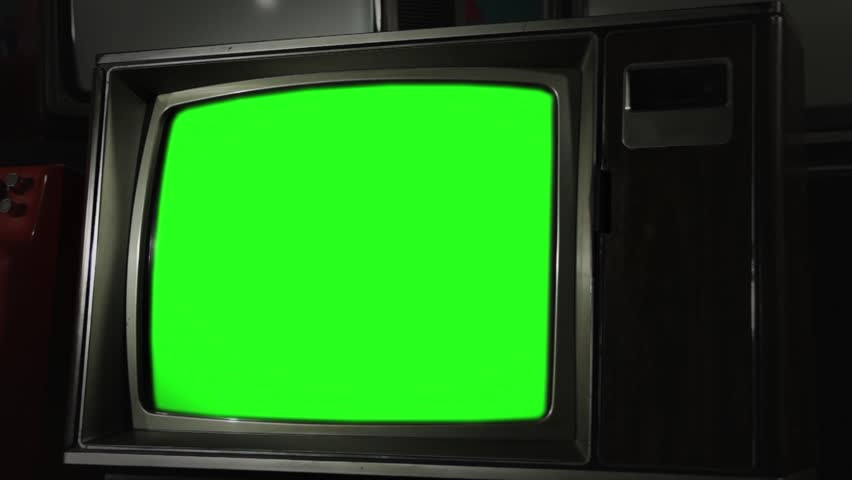 """Old Retro TV with Green Screen and Wooden Style. Zoom In. You can Replace Green Screen with the Footage or Picture you Want with """"Keying"""" effect in After Effects (check out tutorials on YouTube).  