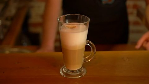 Barista prepares coffee with milk. Barista prepares latte.. Late cup at the Coffee House. Coffee with milk.