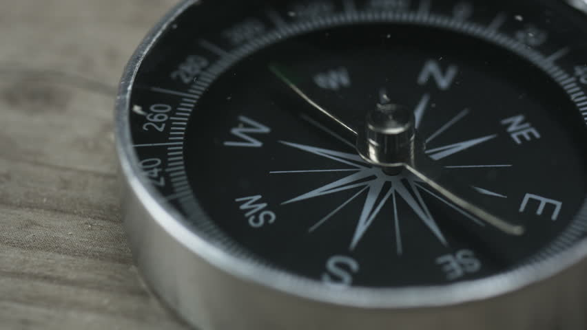 Close up shot of a spinning vintage compass | Shutterstock HD Video #1006836391