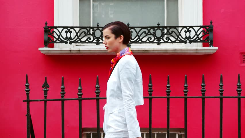 Stylish Woman Carrying Bag Walks Along City Street