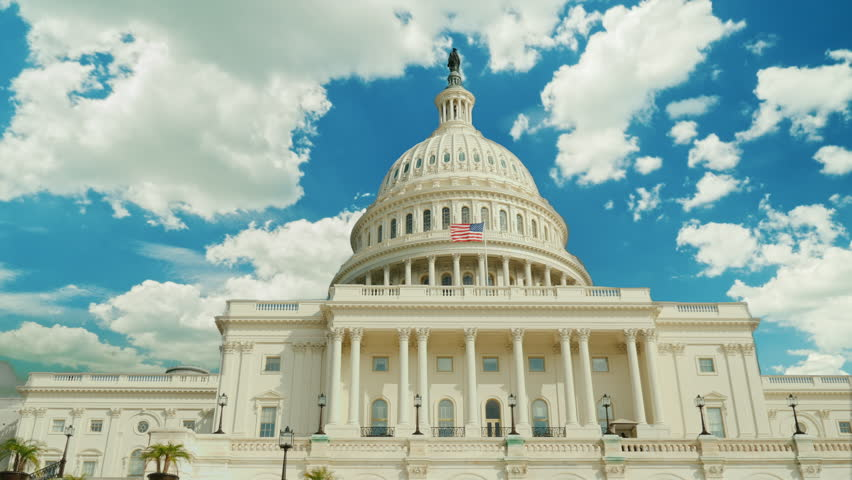 Over the famous Capitol building in Washington, DC, clouds swiftly float. Timelapswe video