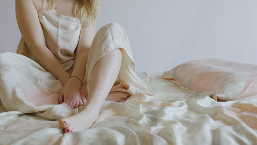 Naked Girl Under Blanket Sits Stock Footage Photo