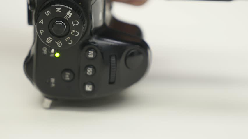 Turning the settings wheel on photo camera   Shutterstock HD Video #1006901116