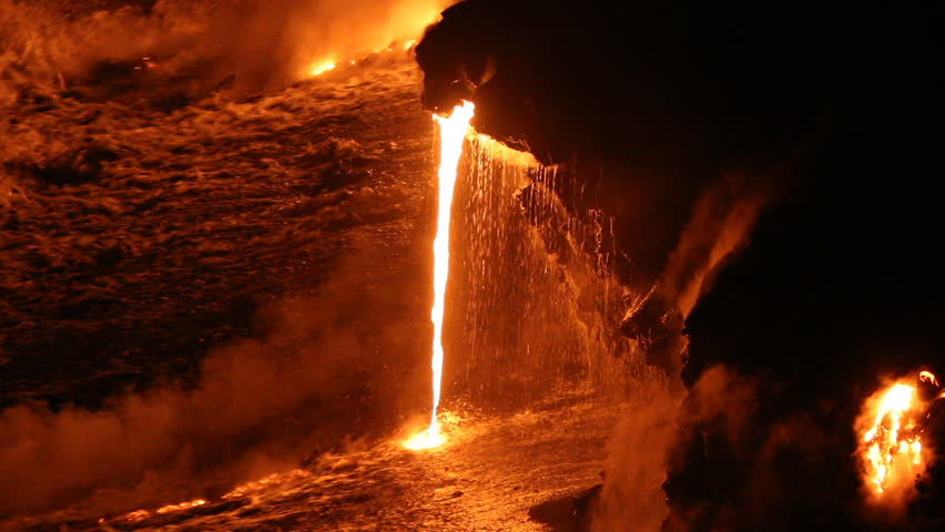 Lava running in the ocean from volcanic lava eruption on Big Island Hawaii. Lava stream flowing in Pacific Ocean from Kilauea volcano by Hawaii volcanoes national park, USA. Night shot 59.94 FPS.