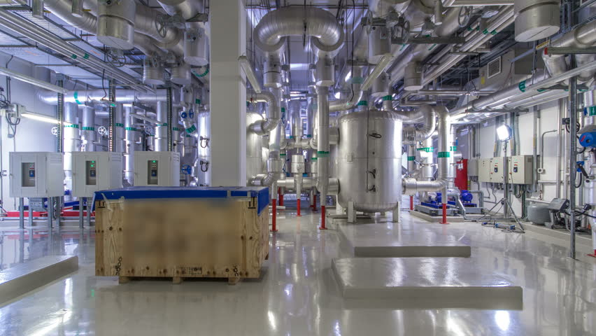 Equipment, cables and piping as found inside of industrial chiller plant room timelapse hyperlapse. Part of data center Royalty-Free Stock Footage #1006919947