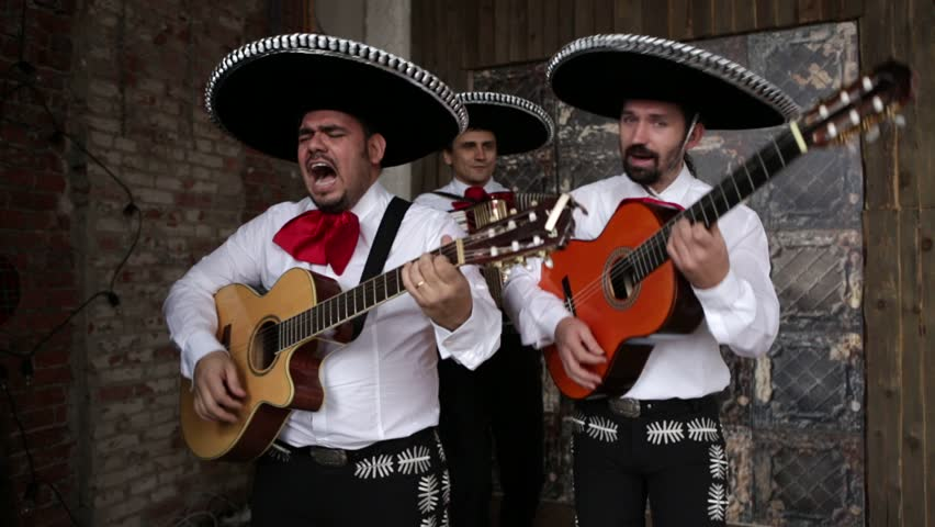 Mexican musician mariachi playing music and sing a serenade