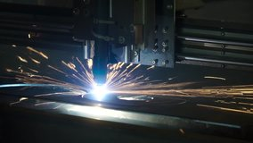 The industrial laser cutting torch cuts preparations from metal. Clip. Laser cutter in the production. Industrial cnc plasma cutting of metal plate