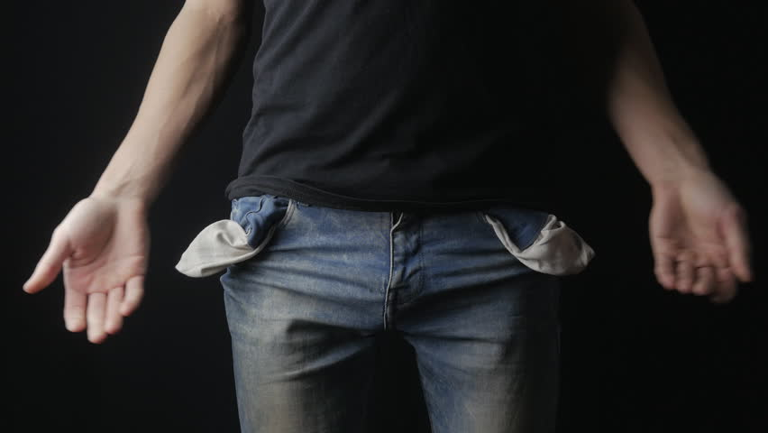 Man Turns the Empty Pockets of His Jeans. No Money