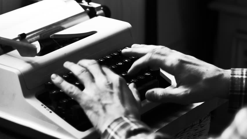 Hands typing a film script or a book on a vintage typewriter, 4k black and white video  | Shutterstock HD Video #1006950817