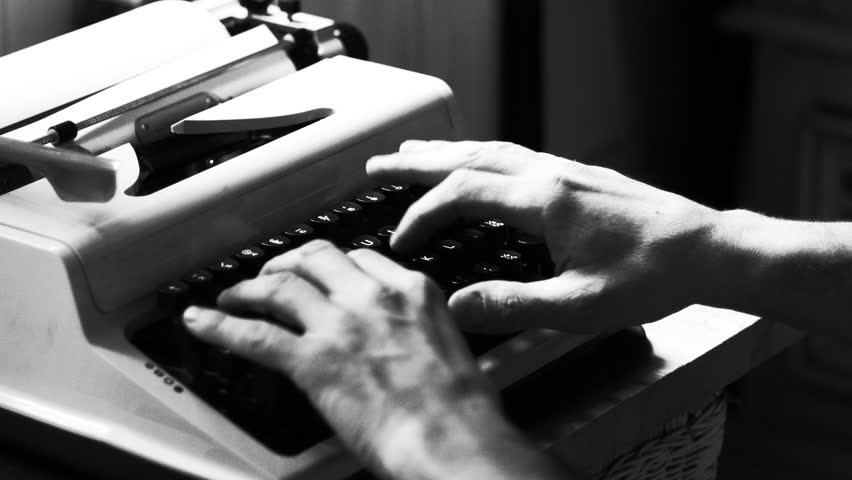 Hands typing a film script or a book on a vintage typewriter, 4k black and white video  | Shutterstock HD Video #1006950820