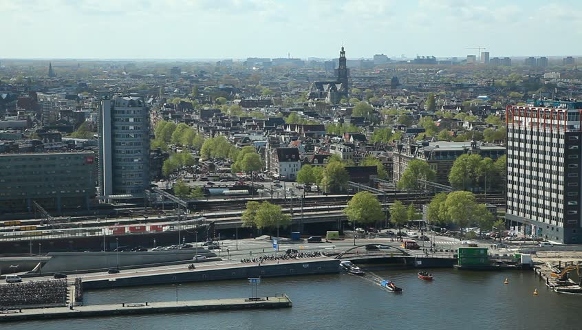 AMSTERDAM, NETHERLANDS - APR 11, 2017 : Panoramic view of Amsterdam. Cityscape with famous canals. Port and Central railway station. Top view from A'dam Tower.    Shutterstock HD Video #1006968526