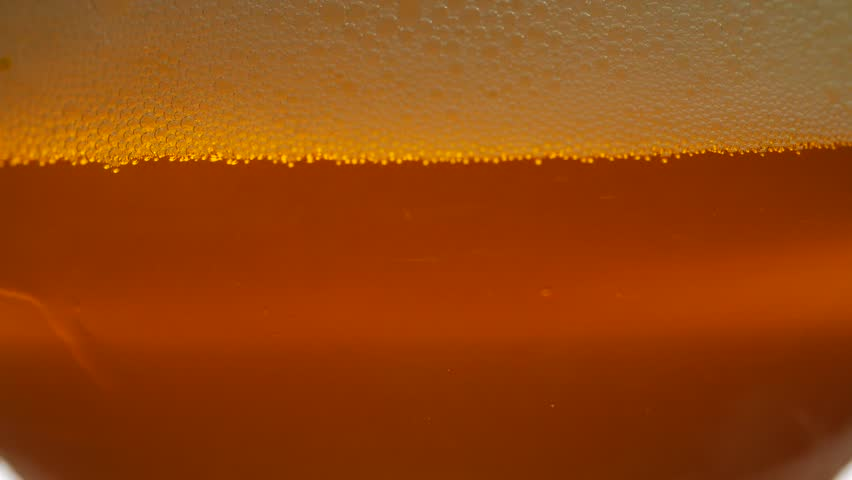 Beer in a glass with bubbles | Shutterstock HD Video #1006980067