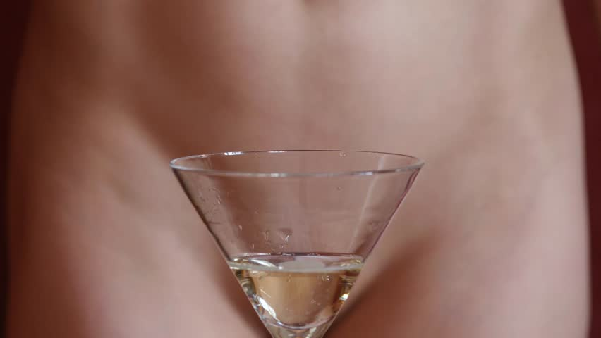 Beautiful young woman without panties pours champagne in glasses in a dark. close-up buttocks and hip | Shutterstock HD Video #1006989319