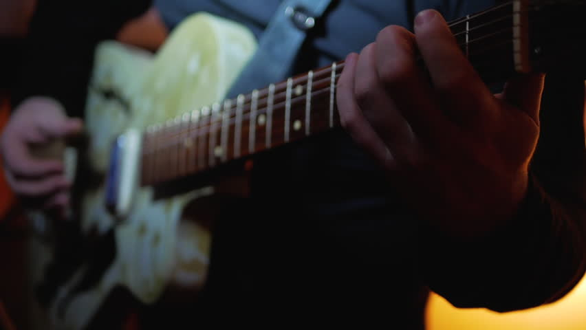 Musician playing by old vintage electric guitar rock music at show close-up | Shutterstock HD Video #1007007988