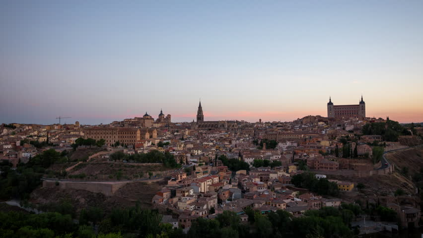 Toledo, Spain old town cityscape at the Alcazar. 4K timelapse video at sunrise time with zooming in camera motion.