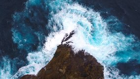 Aerial view by drone 4k camera. Ocean with waves and rocky cliff.  Nusa Penida, Indonesia. zoom in