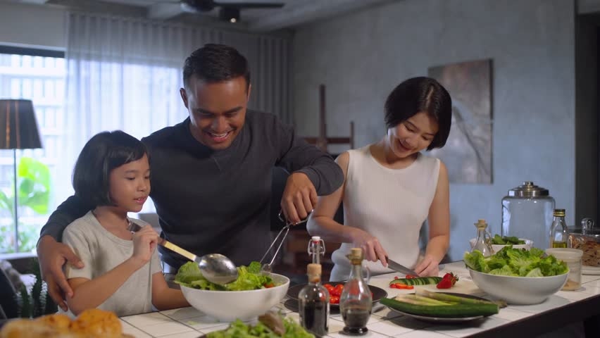 Happy Asian family preparing food in the kitchen. | Shutterstock HD Video #1007048932