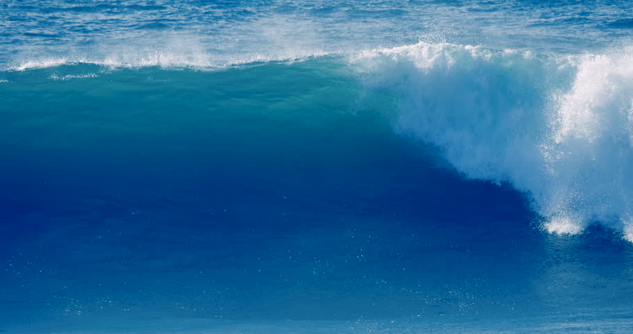 Slow motion close up of big ocean surf wave moving, breaking, crashing, tropical Hawaii shore beach. Deep blue sea water and whitecap of barrel tube splashing, spraying. Nature power slomo background  | Shutterstock HD Video #1007074537