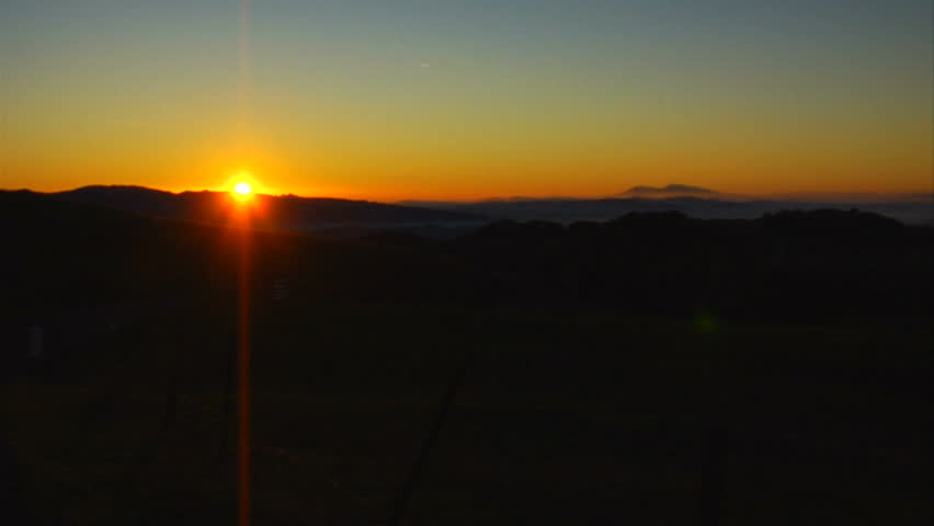 This is a wide locked off shot of a golden Napa Valley sunrise. Timelapse shows