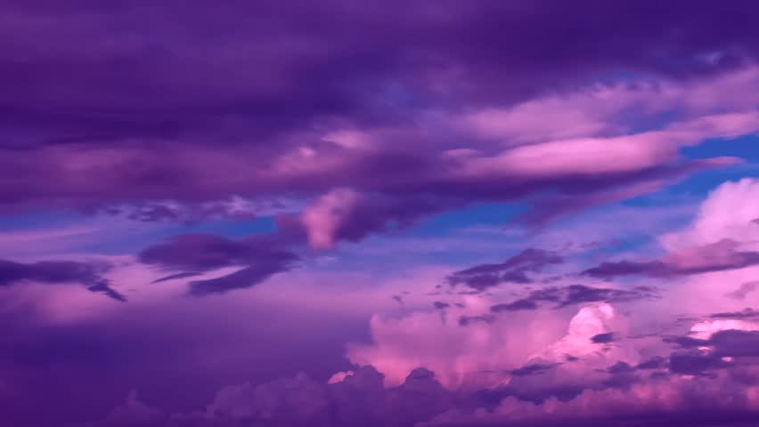 Timelapse of beautiful pink sunset sky turning to blue evening sky 4k cloudscape footage, purple clouds time lapse, beautiful cloudy motion. Beautiful pinc sunset sky turning to blue evening skies. 4K #1007090002