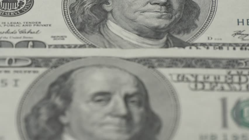 One hundred dollar bills close-up - 2. Macro photography of banknotes. Portrait of Benjamin Franklin. | Shutterstock HD Video #1007114794