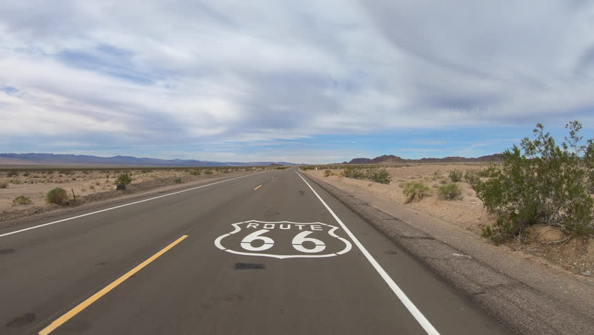 Aerial fly over of Route 66 pavement sign in the California Mojave desert. | Shutterstock HD Video #1007121325