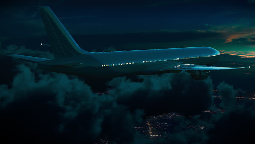 Commercial Passenger Jet Plane Flying Above Night City, Distant Lights and Dark Clouds in Moonlight Royalty-Free Stock Footage #1007129422
