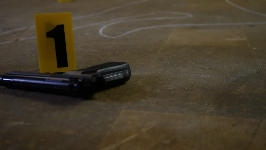 Cinematic camera move past 9mm handgun with evidence marker at active crime scene