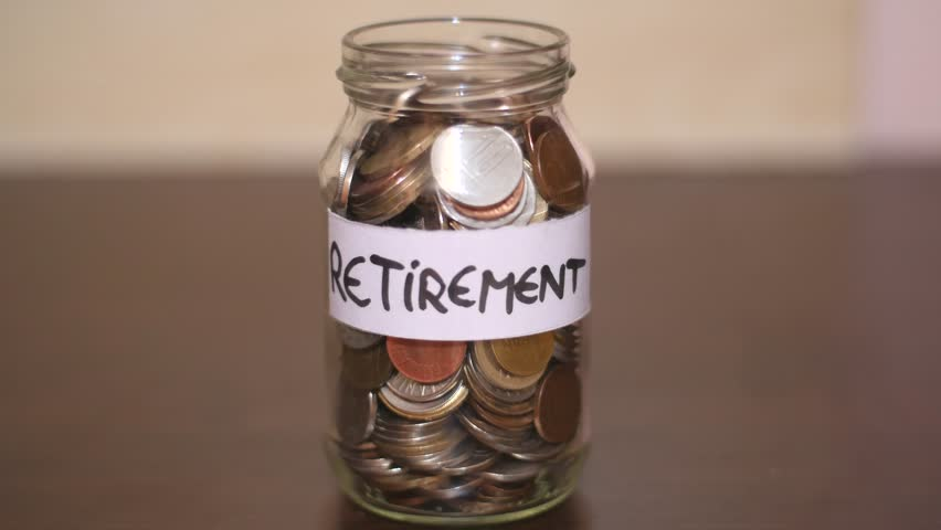 Retirement Investment Coins In A Jar Time Lapse Royalty-Free Stock Footage #1007135848