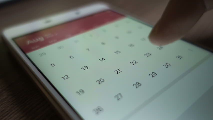 Man using calendar app on the mobile device closeup. Close-up male hands scrolling screen on smartphone. | Shutterstock HD Video #1007144143
