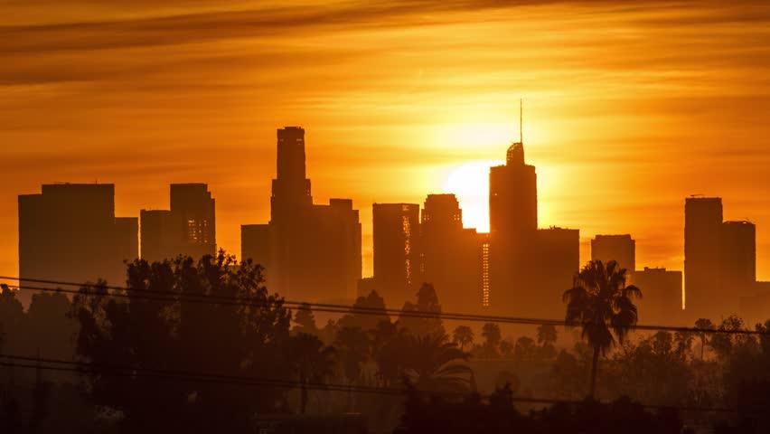 Sunrise sun rising behind downtown Los Angeles skyscrapers, beautiful city skyline. 4K UHD timelapse. | Shutterstock HD Video #1007165227