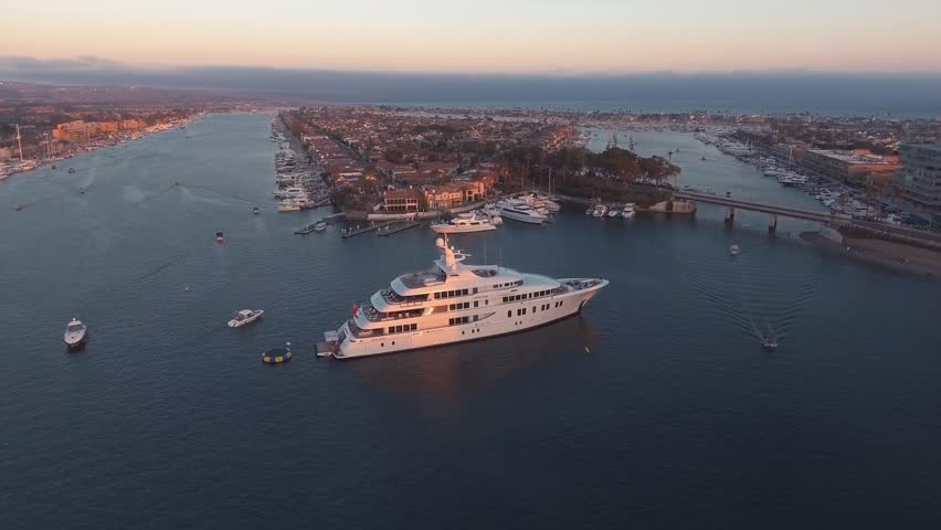 Aerial orbit view of luxury super yacht or mega-yacht docked in harbor | Shutterstock HD Video #1007168194