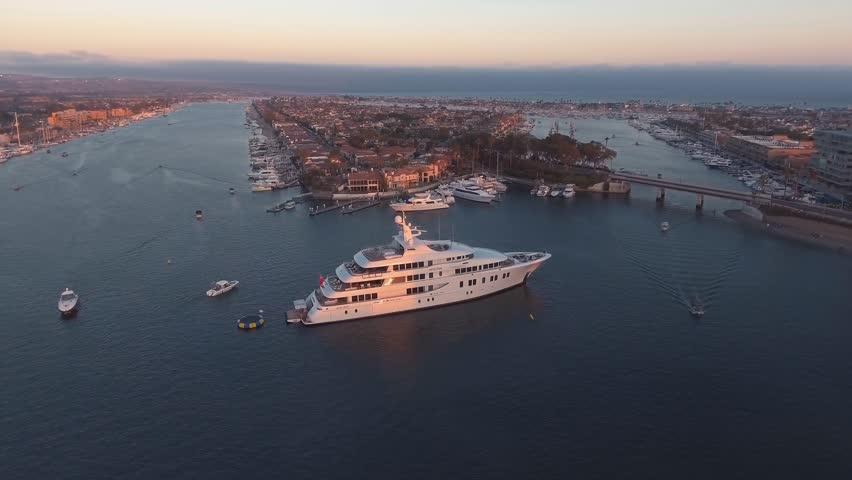 Aerial orbit view of luxury super yacht or mega-yacht docked in harbor | Shutterstock HD Video #1007168194