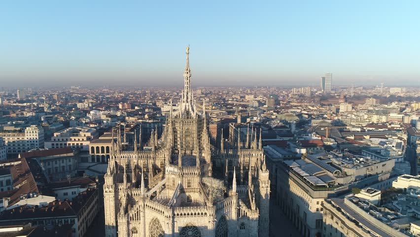 Aerial drone footage of famous statue on cathedral Duomo in Milan Italy // no video editing | Shutterstock HD Video #1007171275