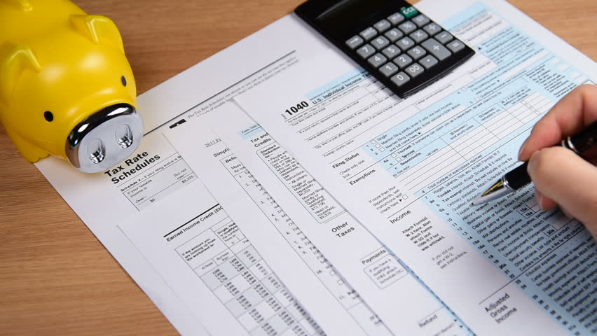 Tax form 1040, pen, Piggy bank and calculator. on the desk. Royalty-Free Stock Footage #1007206168