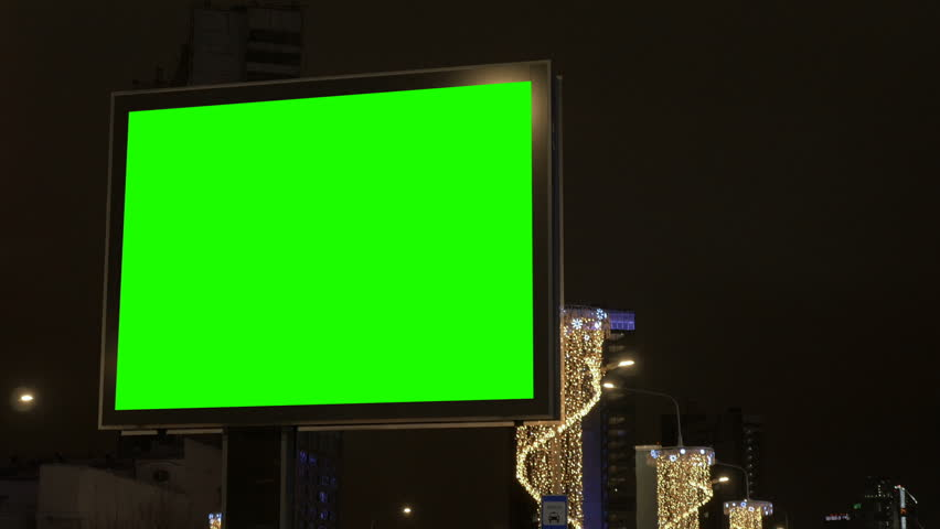 Billboard with a green screen on the street decorated for the holiday. | Shutterstock HD Video #1007212663