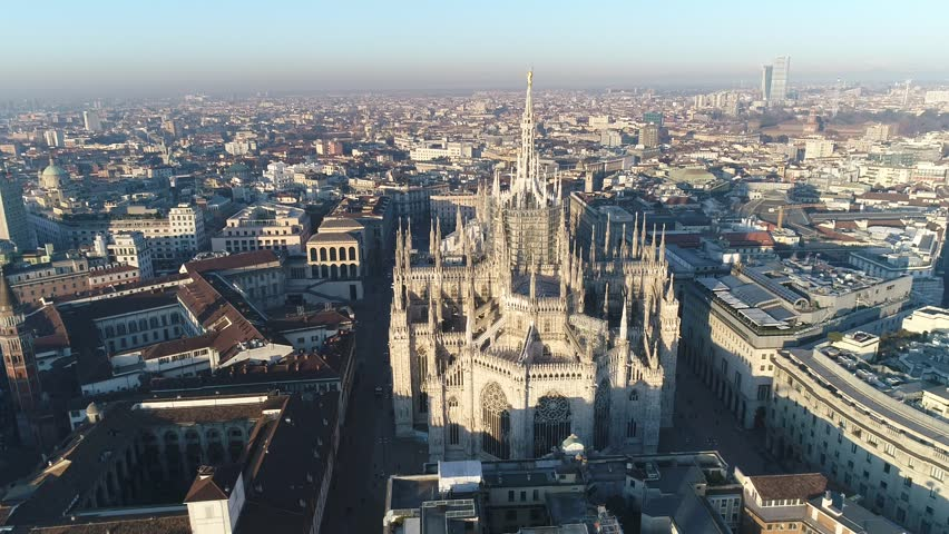 Aerial drone footage of famous statue on cathedral Duomo of Milan Italy // no video editing | Shutterstock HD Video #1007213710