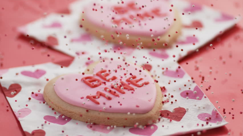 Valentine's Day cookies with sprinkles falling in slow motion.  Shot on Phantom Flex 4K.