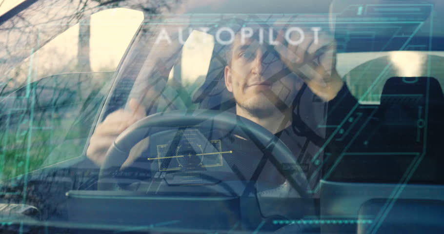 A man drives his futuristic car and when he activates the autopilot the car drives itself and can relax. Concept of: Technology, holography, future, transport and cars.