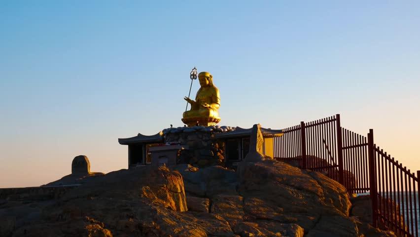 Statue of golden Buddha at the Haedong Yonggung Temple. Busan, South Korea   Shutterstock HD Video #1007264548