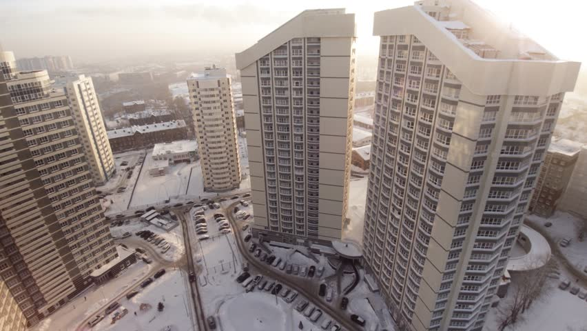 Complex of new apartment residential houses with balconies. Clip. Top view of the luxury residential complex at sunset