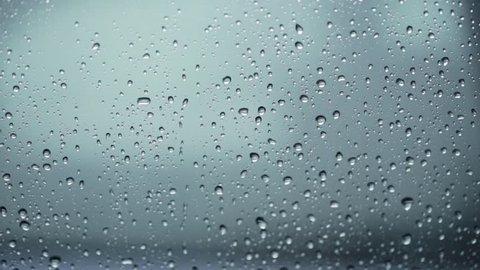 Close up of rain water drops on windscreen window