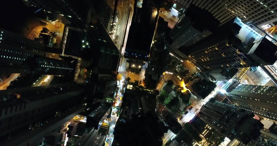 AERIAL. 90 degree View from the dron to nights city streets in Hong Kong